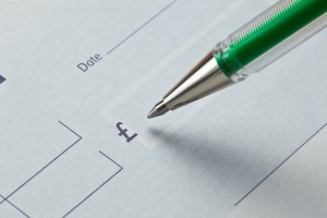 Writing a cheque with green ink